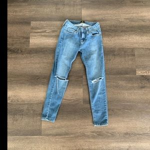 Jeans with holes on the knees